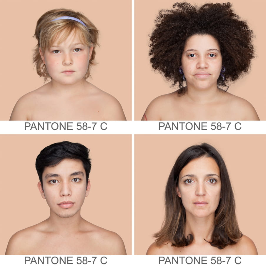 Collage of photographic portraits of four people of different ethnicities. The background is a sample of 11 x 11 pixels taken from the nose of the subject and matched with the industrial pallet Pantone®. They all have the same pantone color, which is written out as PANTONE 58-7C.
