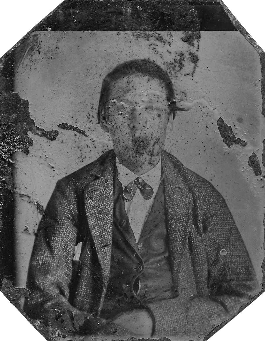 Old damaged photograph of a man, his face barely recognisable because of the damage