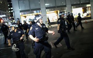 Police officers during a Black Lives Matter demonstration in New York City on July 8, 2016. Photo by Kena Betancur / AFP