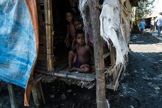 A mother with her two children in Aung Mingalar. Photo by Andreas Staahl