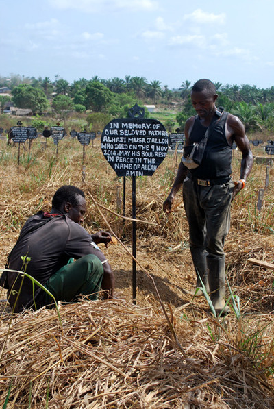 Mariama Jalloh searches for her father's grave in Bo. The gravedigger's tattered notebook is the only record of where thousands of Ebola victims are buried. Photos by Laurence Ivil